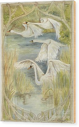 Flying Swans Wood Print by Morgan Fitzsimons