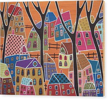 Four Trees And Houses On Orange Wood Print by Karla Gerard