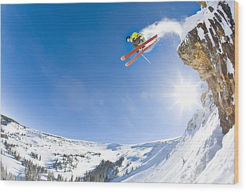 Freestyle Skier Jumping Off Cliff Wood Print by Tyler Stableford