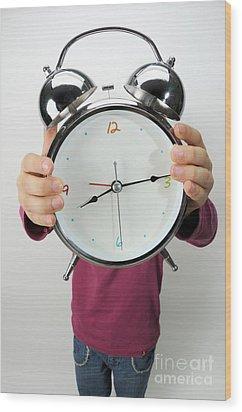 Girl Holding Alarm Clock Over Face Wood Print by Sami Sarkis