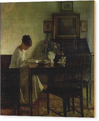Girl Reading In An Interior  Wood Print by Carl Holsoe