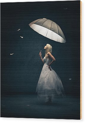 Girl With Umbrella And Falling Feathers Wood Print