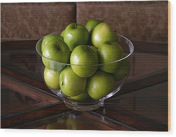 Glass Bowl Of Green Apples  Wood Print by Michael Ledray