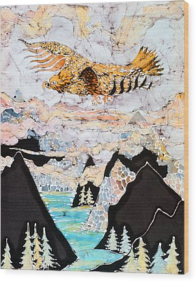 Golden Eagle Flies Above Clouds And Mountains Wood Print by Carol  Law Conklin