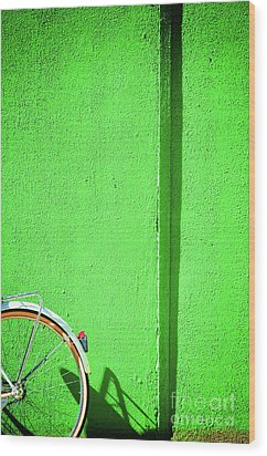 Wood Print featuring the photograph Green Wall And Bicycle Wheel by Silvia Ganora