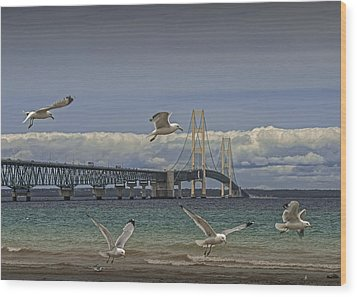 Gulls Flying By The Bridge At The Straits Of Mackinac Wood Print by Randall Nyhof