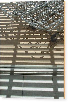 Gurneys Under A Pergola Through A Picture Window Wood Print