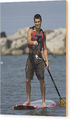 Guy Paddling On Paddleboard Wood Print by Christopher Purcell