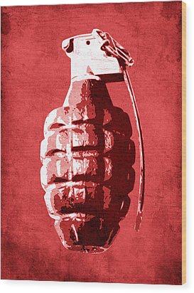 Hand Grenade On Red Wood Print by Michael Tompsett