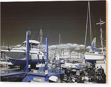 Hanging Boats Wood Print by John Rizzuto