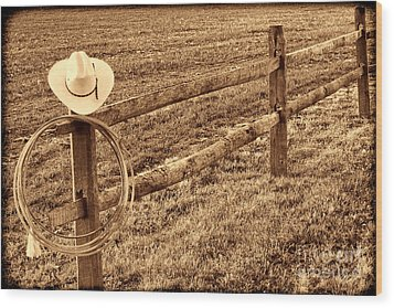 Hat And Lasso On Fence Wood Print