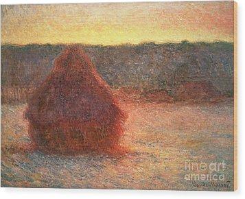 Haystacks At Sunset Wood Print by Claude Monet