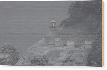 Heceta Lighthouse Snowstorm Wood Print by Kenny Henson