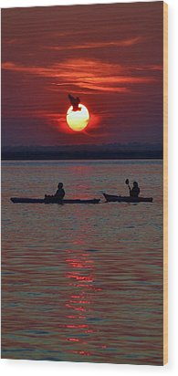 Heron And Kayakers Sunset Wood Print by William Bartholomew