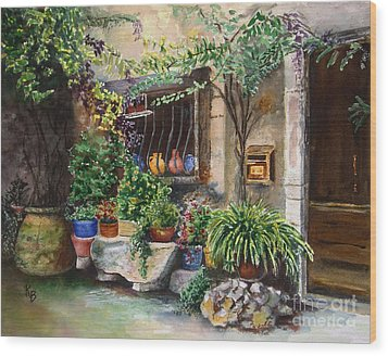 Hidden Courtyard Wood Print by Karen Fleschler