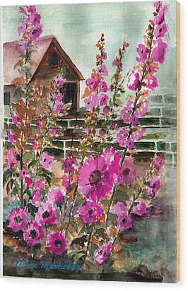 Hollyhocks And Barn Wood Print by George Markiewicz