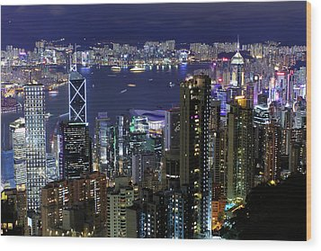 Hong Kong At Night Wood Print by Leung Cho Pan