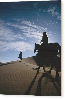 Horseback Riders In Silhouette On Sand Wood Print by Axiom Photographic