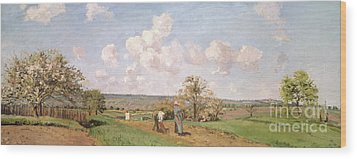 In The Fields Wood Print by Camille Pissarro