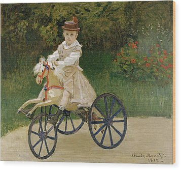 Jean Monet On His Hobby Horse           Wood Print by Claude Monet