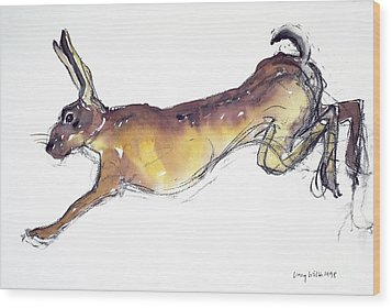 Jumping Hare Wood Print by Lucy Willis