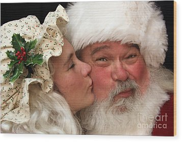 Kissing Santa Claus Wood Print by Joanne Coyle