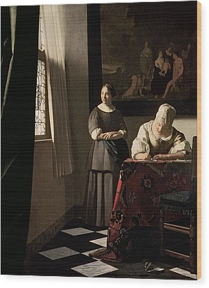 Lady Writing A Letter With Her Maid Wood Print by Jan Vermeer