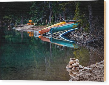 Kayaks At Rest Wood Print by Menachem Ganon