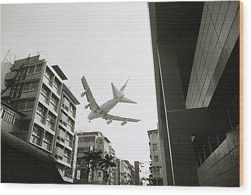 Landing In Hong Kong Wood Print by Shaun Higson