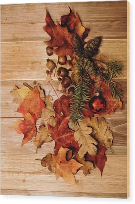 Wood Print featuring the photograph Leaves And Nuts And Red Ornament by Rebecca Cozart
