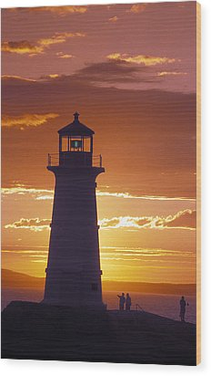 Lighthouse At Sunset In Peggys Cove Wood Print by Richard Nowitz