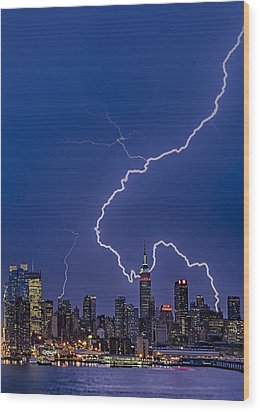 Lightning Bolts Over New York City Wood Print by Susan Candelario