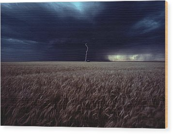 Lightning Flashes Above A Kansas Wheat Wood Print by Cotton Coulson