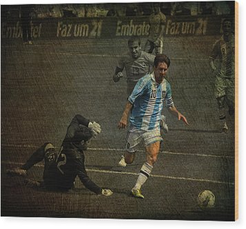 Lionel Messi Breaking Raphael Cabrals Ankles  Wood Print by Lee Dos Santos