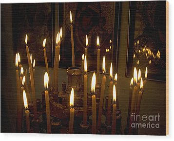 lit Candles in church  Wood Print by Danny Yanai