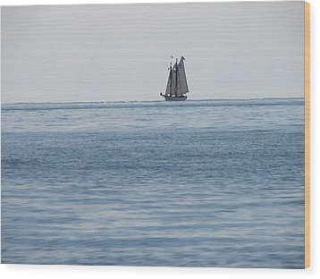 Lone Ship At Sea Wood Print by Ginger Howland
