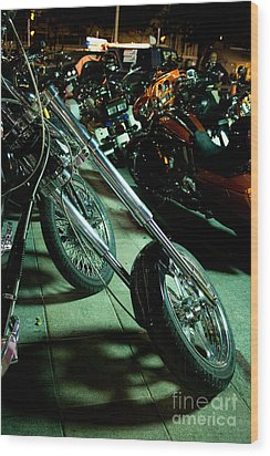 Long Front Fork And Wheel Of Chopper Bike At Night Wood Print by Jason Rosette
