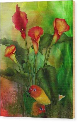 Love Among The Lilies  Wood Print by Carol Cavalaris