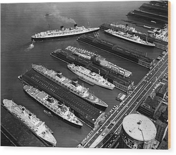 Luxury Liners Flanking An Aircraft Wood Print by Everett