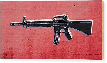 M16 Assault Rifle On Red Wood Print by Michael Tompsett