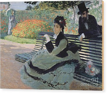 Madame Monet On A Garden Bench Wood Print by Claude Monet