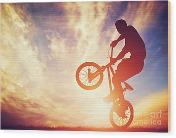 Man Riding A Bmx Bike Performing A Trick Against Sunset Sky Wood Print by Michal Bednarek