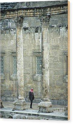 Man Walking Between Columns At The Roman Theatre Wood Print by Sami Sarkis