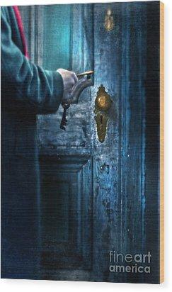 Man With Keys At Door Wood Print by Jill Battaglia