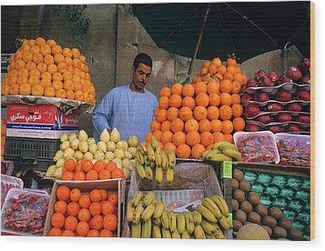 Market Vendor Selling Fruit In A Bazaar Wood Print by Sami Sarkis