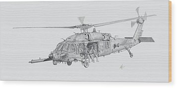 Mh60 With Gun Wood Print by Nicholas Linehan