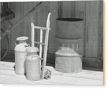 Milk Cans And Fire Barrel Wood Print by Troy Montemayor