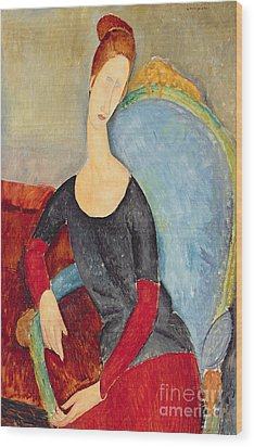 Mme Hebuterne In A Blue Chair Wood Print by Amedeo Modigliani