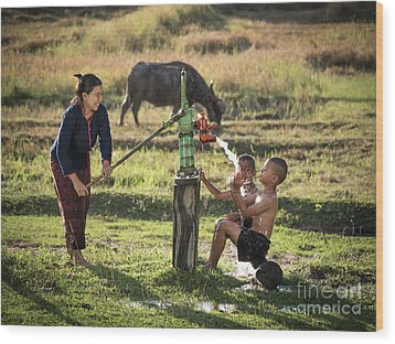 Wood Print featuring the photograph Mother Her Sons Shower Outdoor From Groundwater Pump. by Tosporn Preede