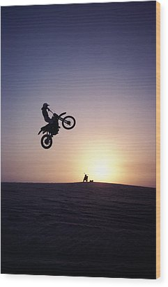 Motorcyclist In Mid-air Jump Wood Print by James Porto